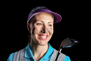 Golf player holding golf club on black background