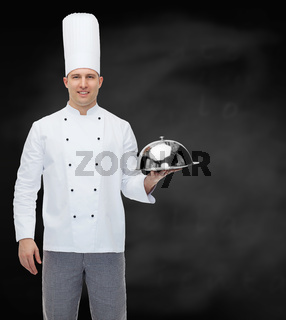 happy male chef cook holding cloche