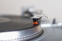 Turntable tone-arm cartridge playing record