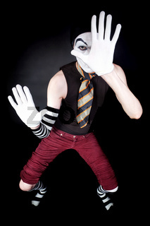 Funny mime in white gloves