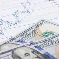 Stock market graph with hundred dollars banknote - studio shot