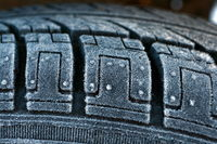 The tire is covered with frost.