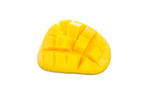 Fresh ripe juicy sliced mango on a white background