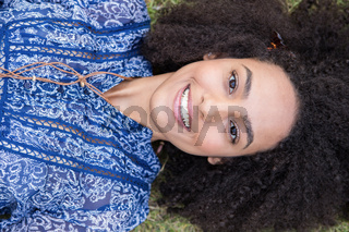 Pretty young woman smiling at camera