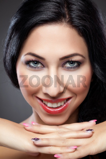 Young beautiful woman with perfect skin and nails