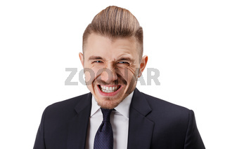Close up of bearded atrractive young man  having fun while posing on camera.