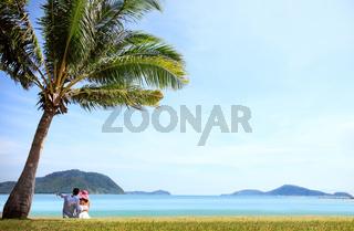 Couple sitting near the sea
