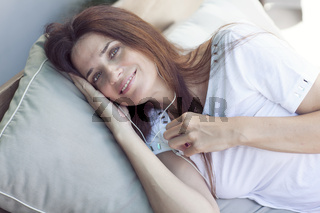woman relaxing in hammock at home