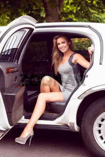 Beautiful blonde stepping out of limousine