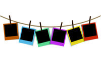Empty colorful photo frames hanging on rope