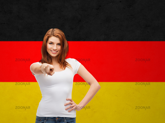 woman in t-shirt pointing at you over german flag