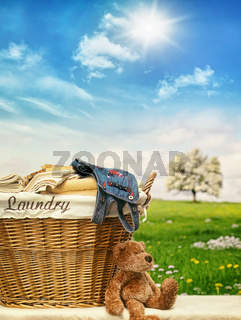 Laundry basket with clothes against a blue sky