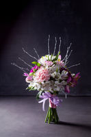Pink bouquet from gillyflowers and alstroemeria on blackboard