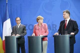 Merkel meets Hollande and Poroschenko in Berlin.
