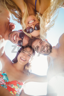group of friends in swimsuits taking a selfie