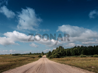 Empty road with cloudy sky.
