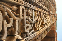 Beautiful carving on the arch in the entrance of Qutab Minar, Delhi India