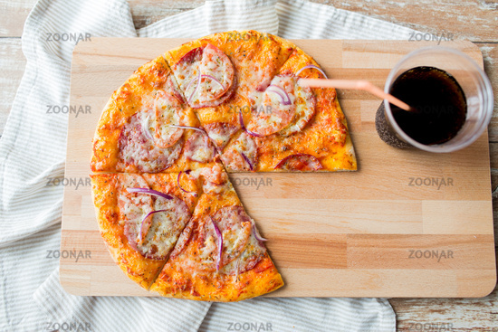 close up of pizza with coca cola on table