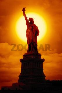 liberty statue at sunset