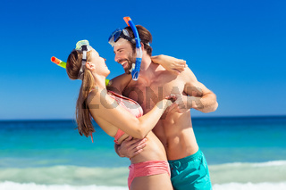 Couple embracing each other on beach