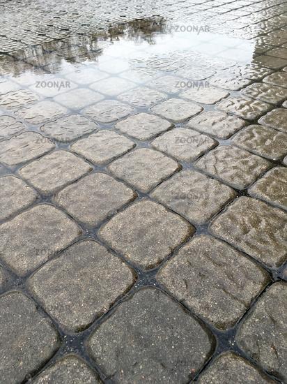 wet modern pavement background closeup