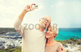 senior tourists couple with camera photographing