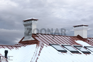 snow roof with chimneys and skylights