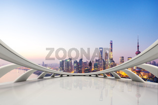 empty smooth marble floor and reflection of cityscape in blue sky