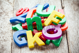 Pile of colorful plastic letters