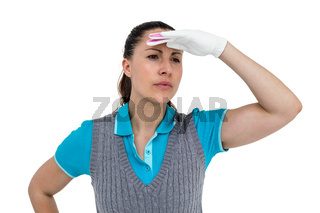Golf player with shielding eyes