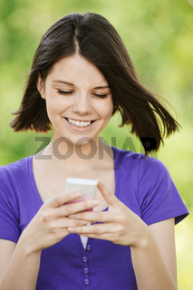 young smiling woman with mobile phone