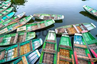 Vietnamese boats at river. Ninh Binh. Vietnam