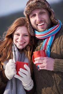 couple drink warm tea at winter