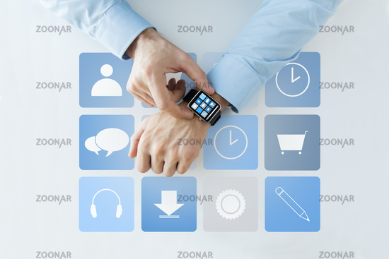 hands with application icons on smart watch