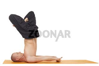 Yoga exercise. Flexible man, isolated on white