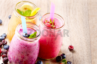 Assorted fruit shakes on white table