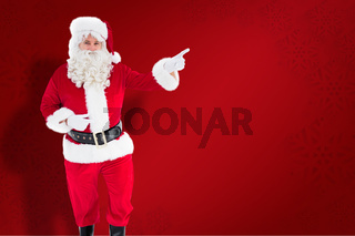 Composite image of portrait of santa claus doing gesture