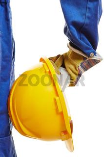 Hand von Arbeiter mit Helm
