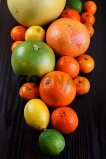 Mound citrus on wooden background macro