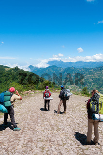 Group of people with backpacks taking a picture and hiking the mountain Tajamulco on pathway