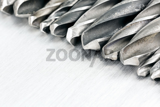 Row of drill bits