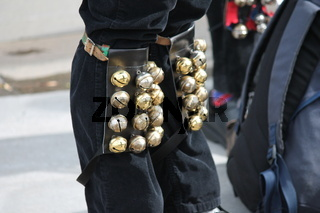 Ribbons and bells on Morris dancers legs while dancing