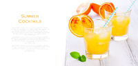 Summer yellow orange lemonade with ice and peaces of blood oranges and straw on a wooden table on a white background with place for text