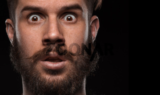 Close-up portrait of amazed guy