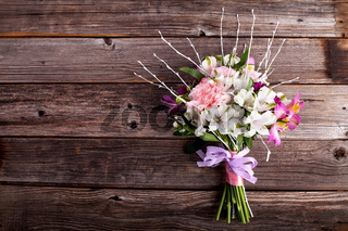 Summer bouquet from gillyflowers and alstroemeria on old wooden background
