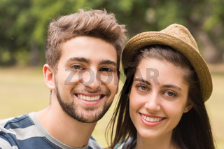 Young couple smiling at the camera