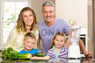 Happy family preparing healthy smoothie