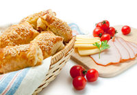 Puff pastry patties with cheese ham sesame and cherry tomatoes.