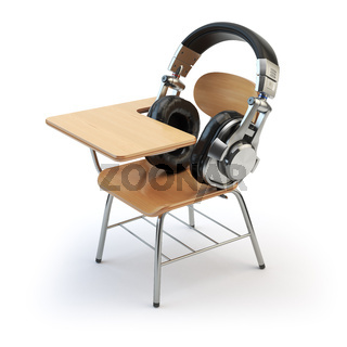 Webinar training or audiobooks  concept. E-learning education online. Headphones and schooldesk isolated on white.
