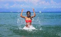 Girl splashing seawater